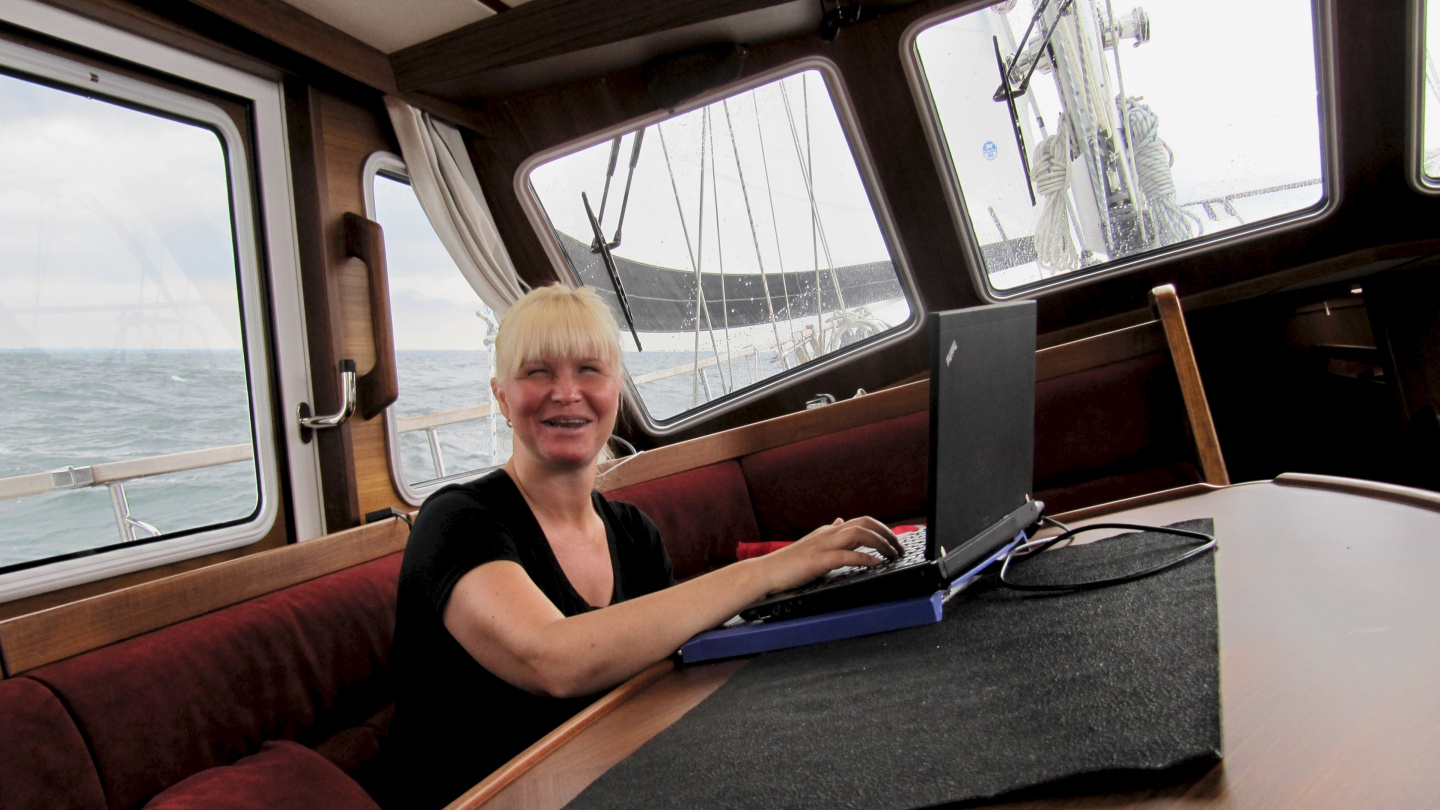 Eve updating the sailing blog on the Sound