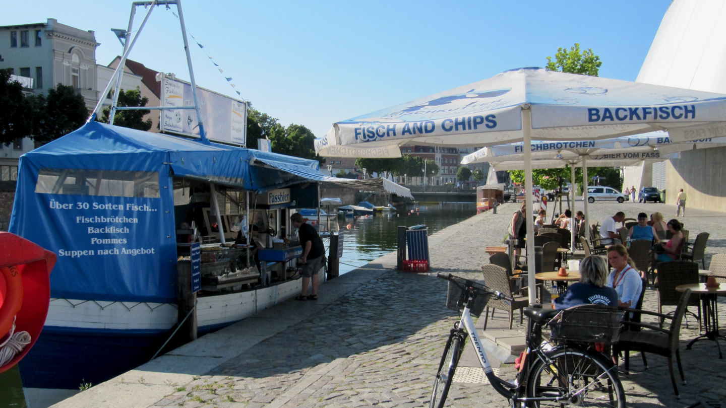 Fresh smoked fish are sold directly from smokery boat in Stralsund
