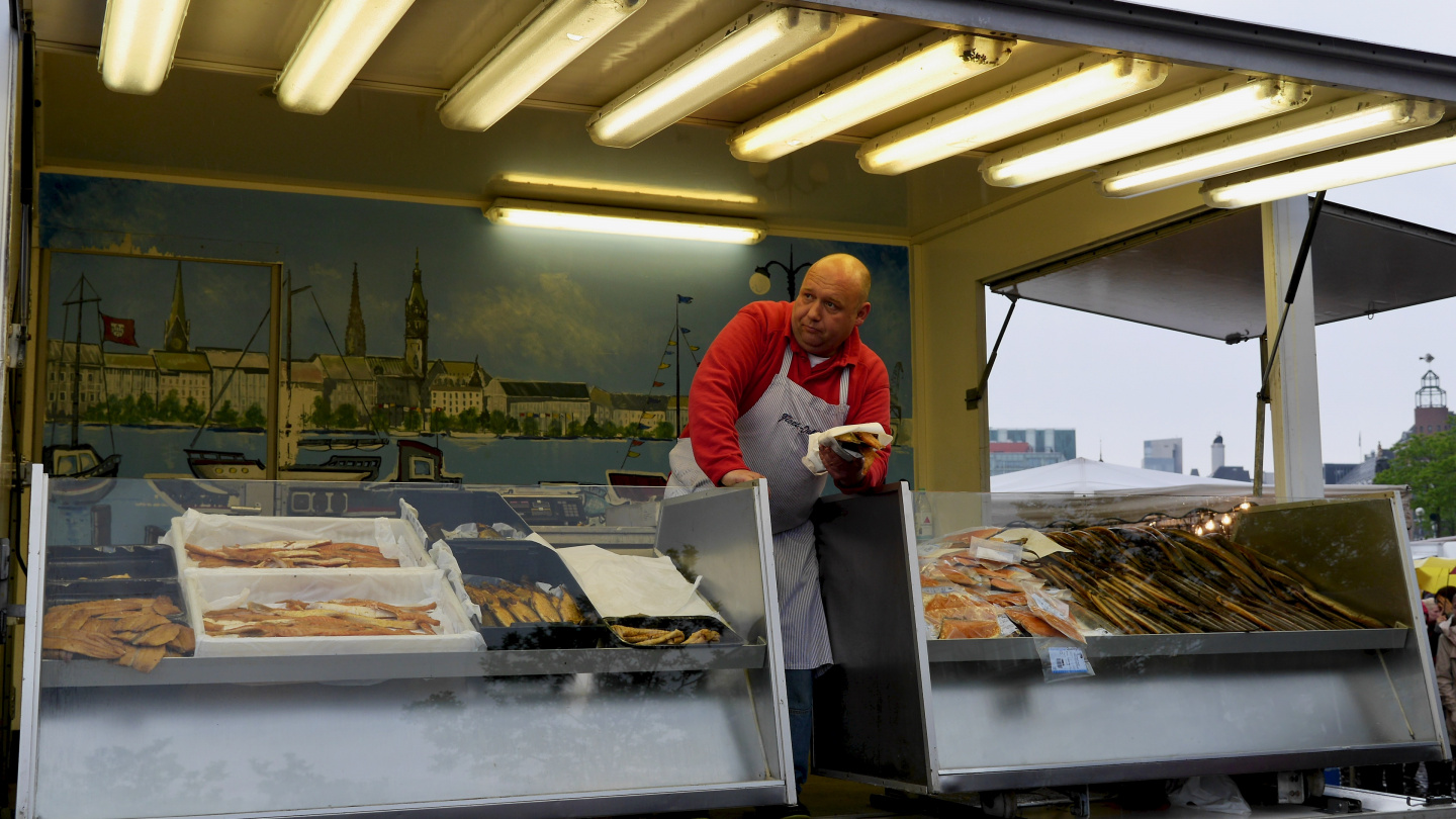 Fish merchant at Fischmarkt of Hamburg