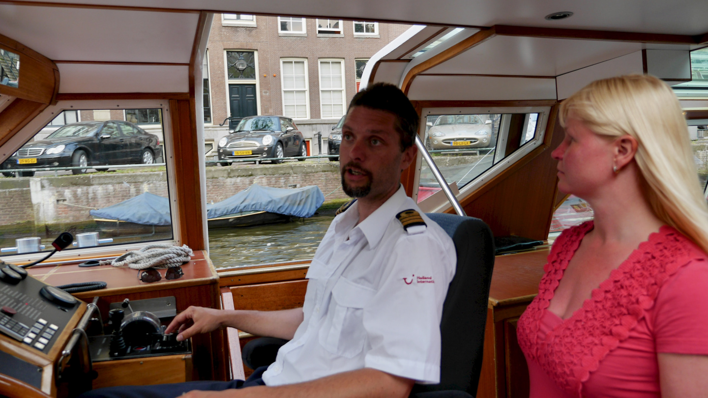 Eve chatting with the skipper of the canalboat in Amsterdam