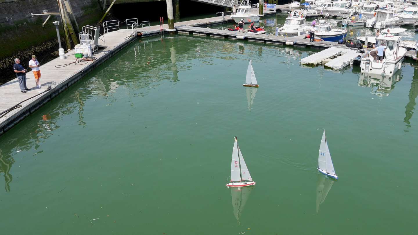 RC controlled sailing boats in the harbour of Dieppe