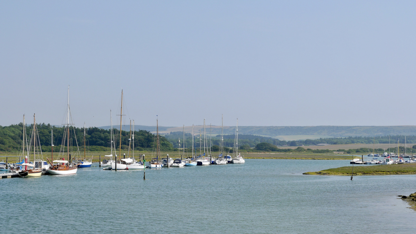 Local yachts moored on the river Yar on the Isle of Wight