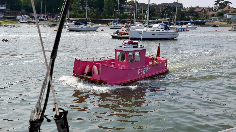 Cute miniature ferry crossing the river Hamble