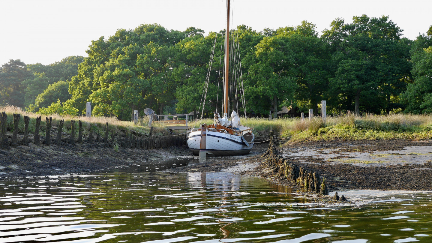 Traditional boat in a mud berth on the Beaulieu river