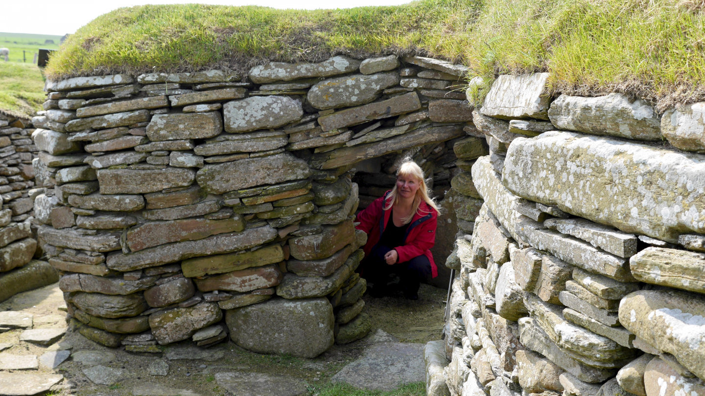 Eve exploring the real stone age house of Skara Brae