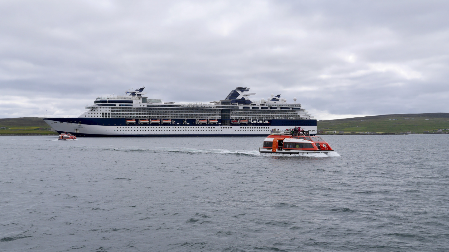 Passengers of Celebrity Cruise are tendered to the town of Lerwick