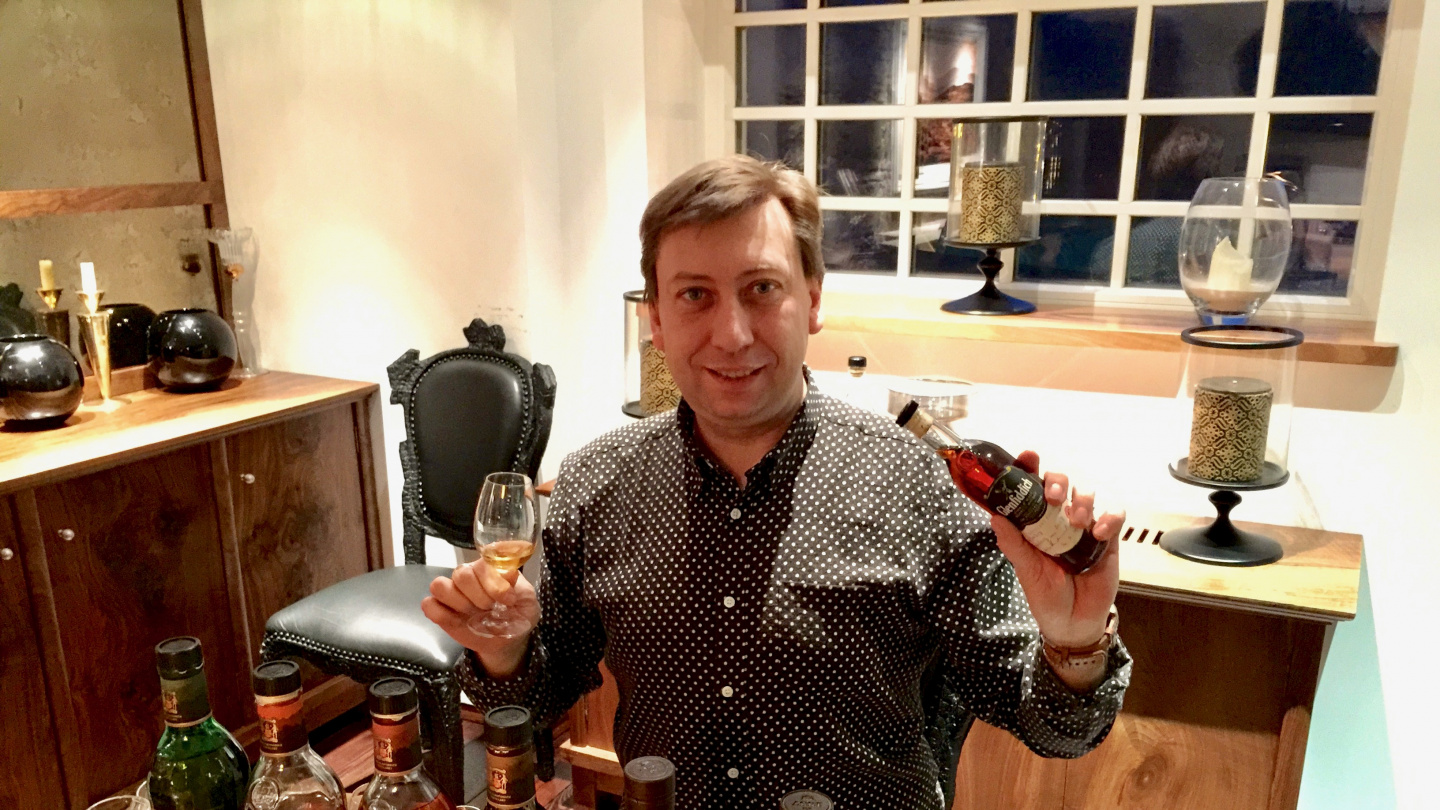 Andrus tasting whiskey at Glenfiddich distillery