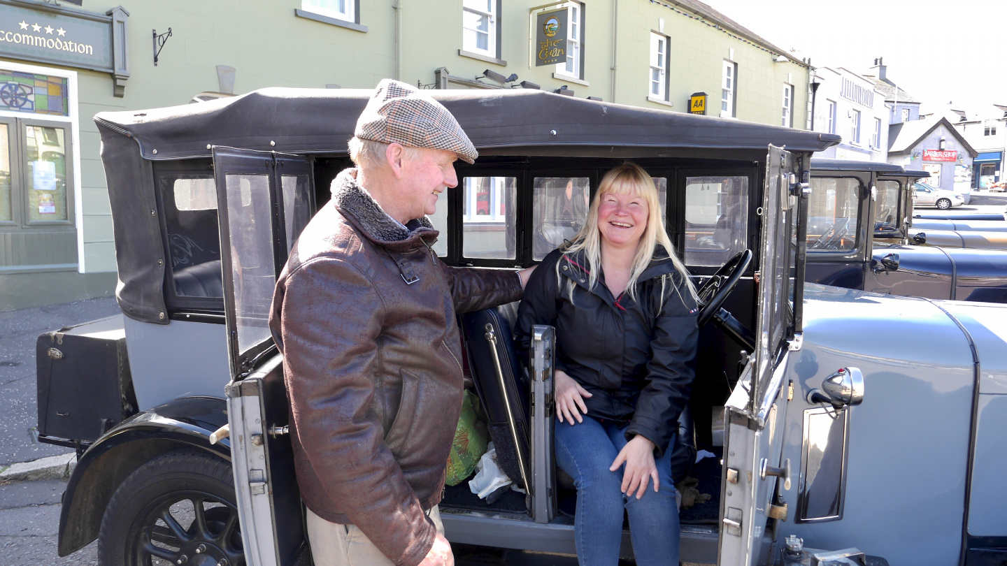 Mr George presenting his Austin to Eve in Strangford
