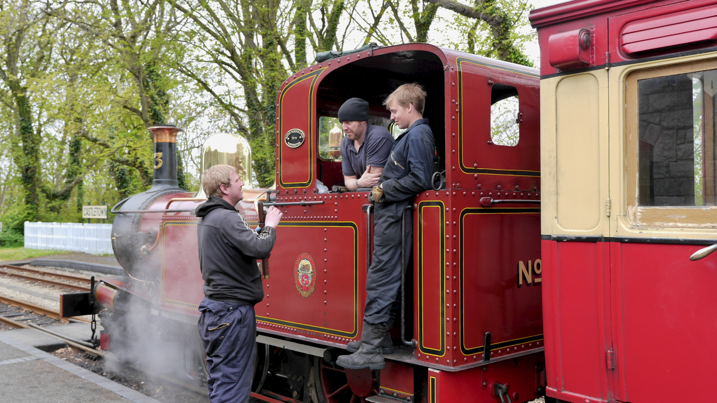 Drivers of the steam locomotive at the break on the Isle of Man