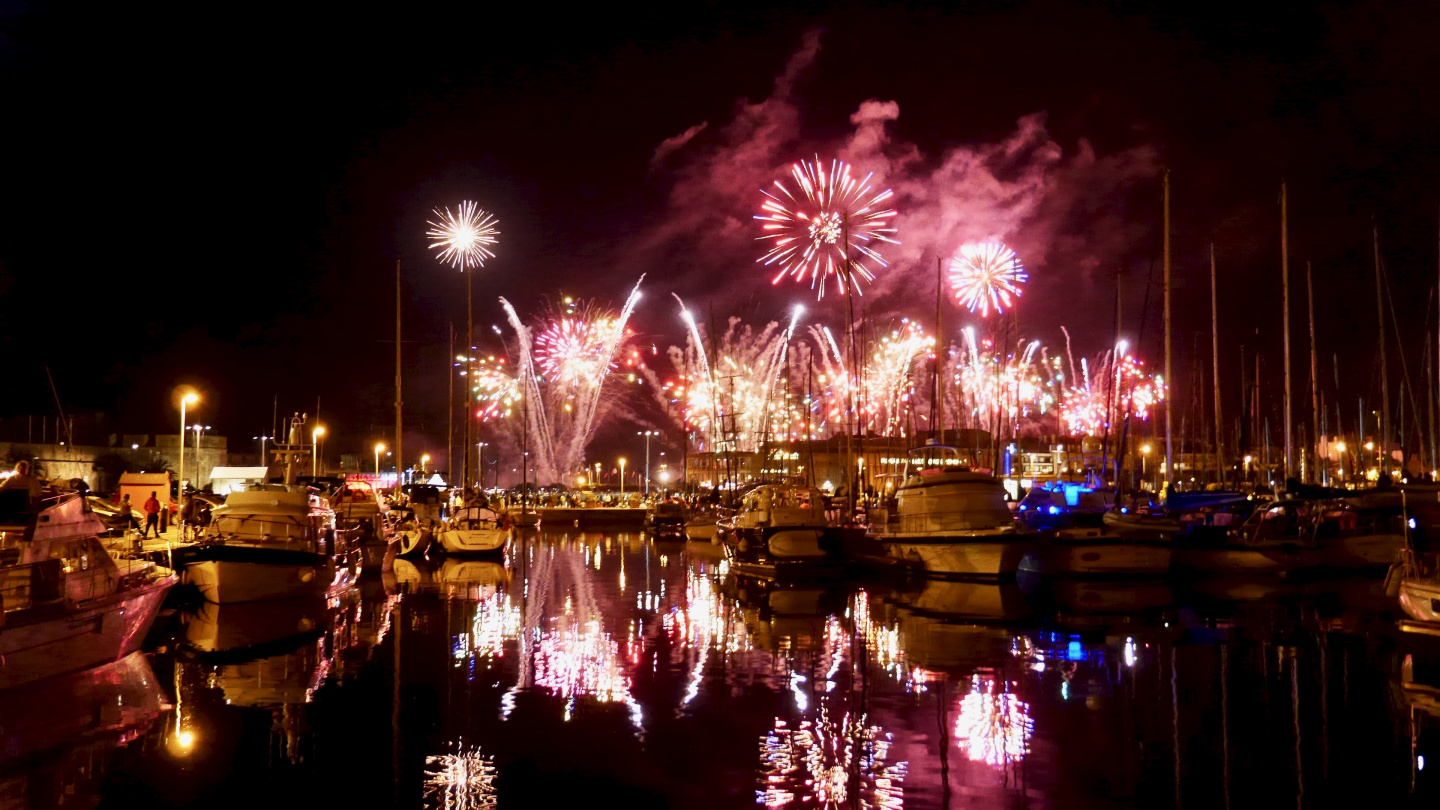 Fireworks of French national day in Bassin Vauban marina in St Malo