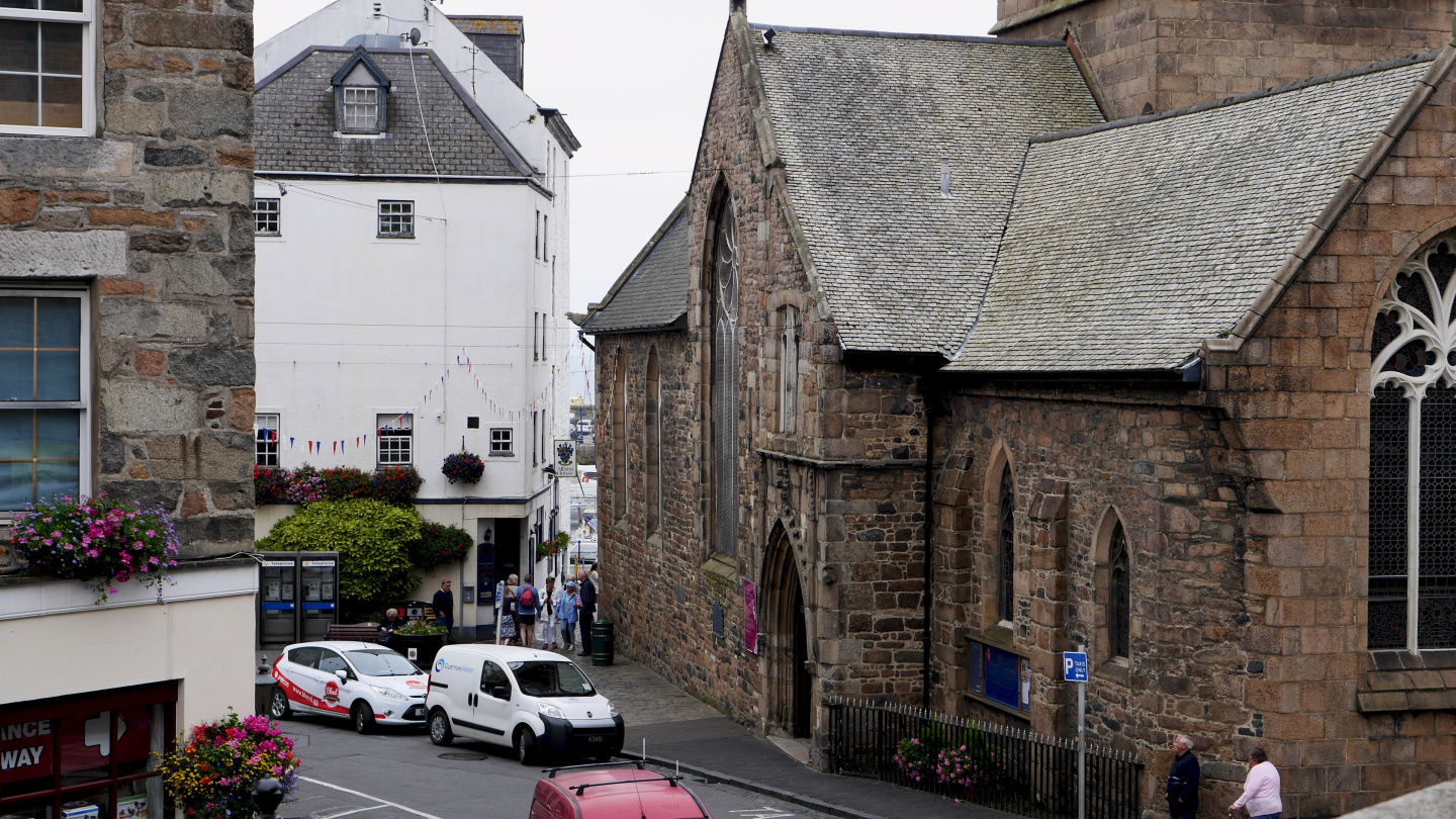 The Albion House pub next to a church in Guernsey