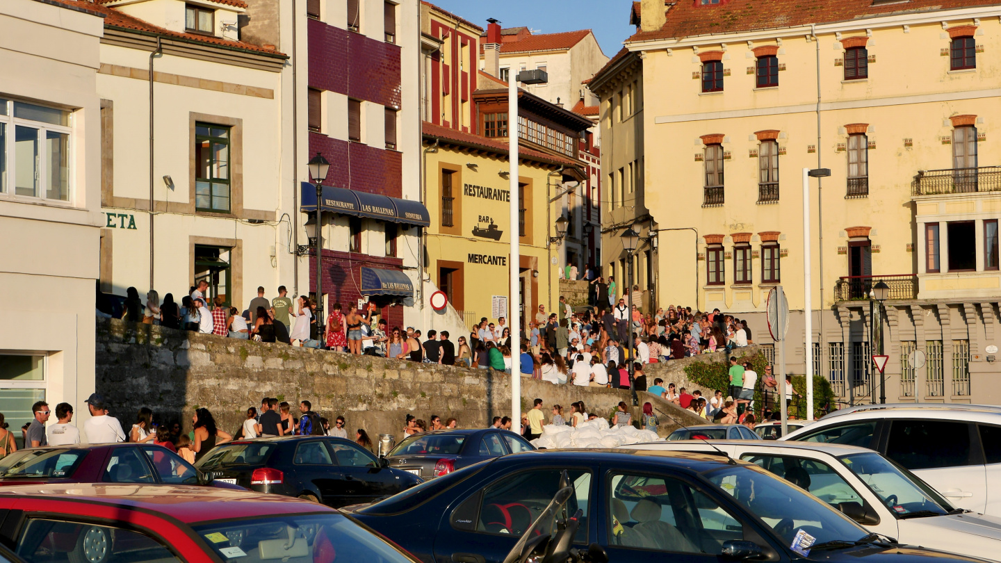The youth partying in the waterfront of Gijon in Spain