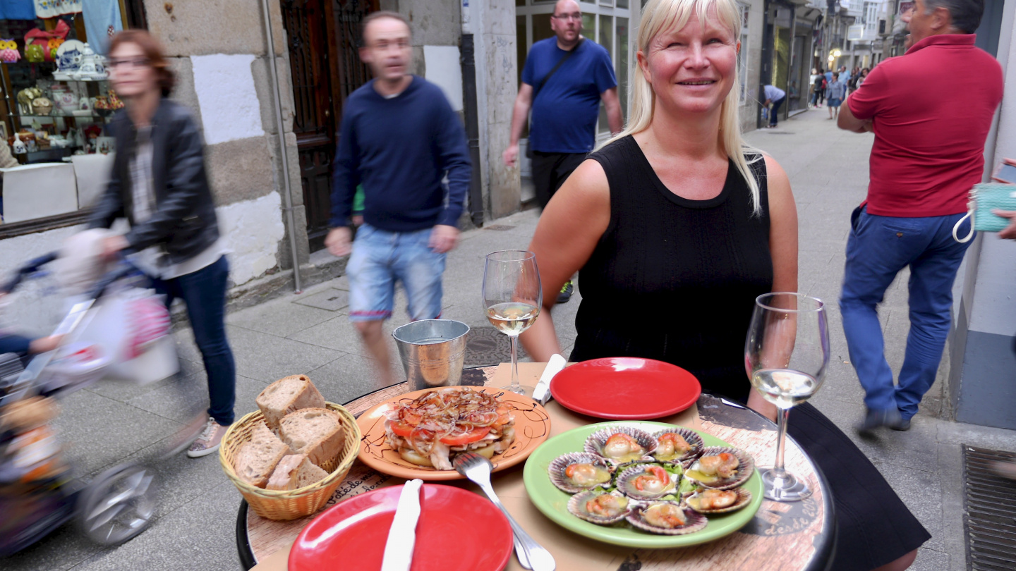 Eve having galician dinner in Viveiro in Spain