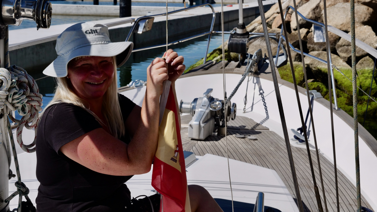 Hoisting of Spanish courtesy flag in Xufre boatyard, Galicia